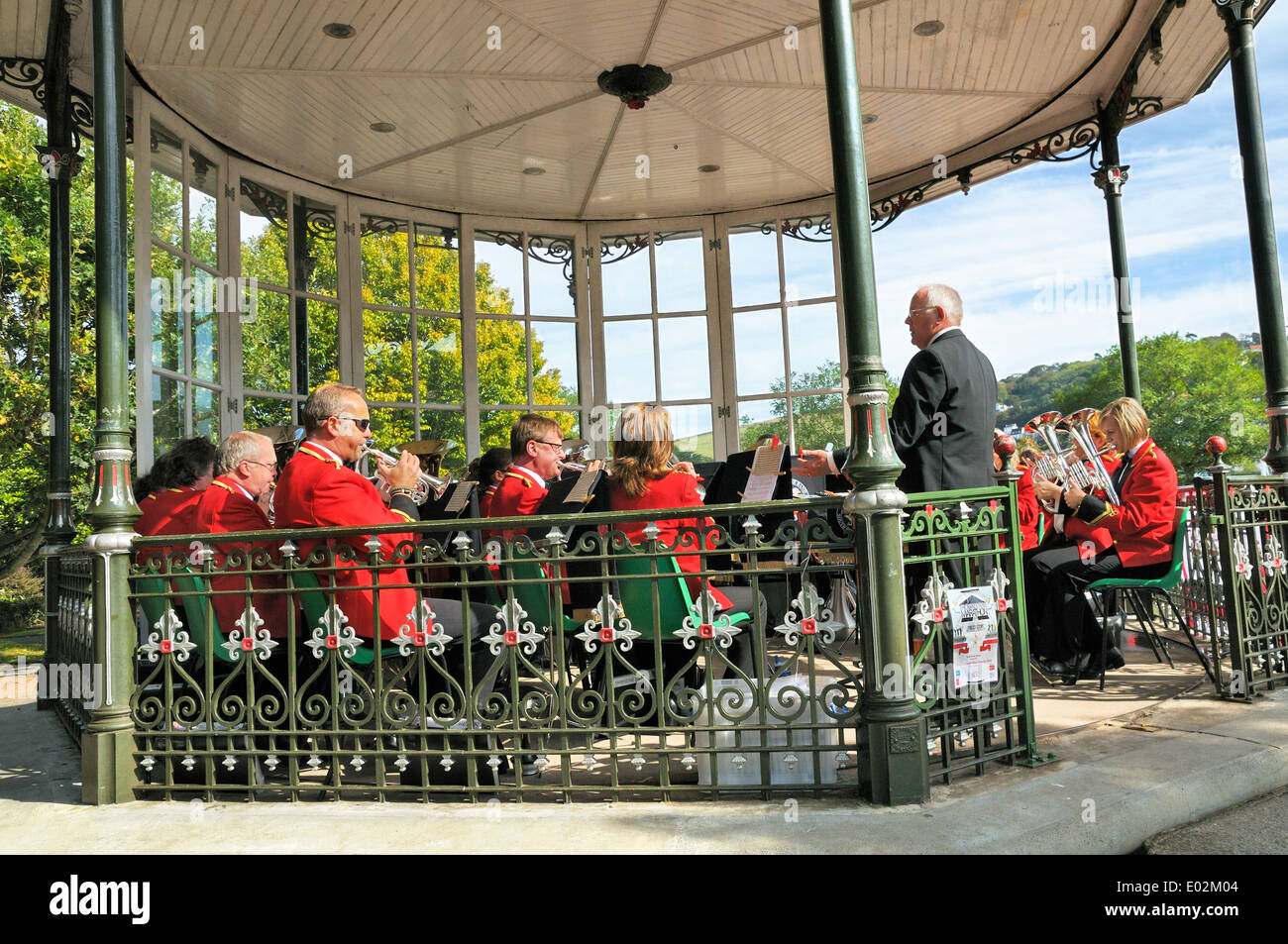 Brass band performing in bandstand, Dartmouth, Devon, UK - Stock Image