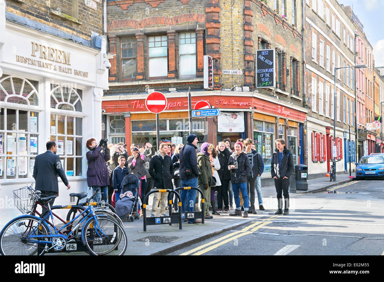 Guided tour in Brick Lane, Tower Hamlets, East London, UK - Stock Image