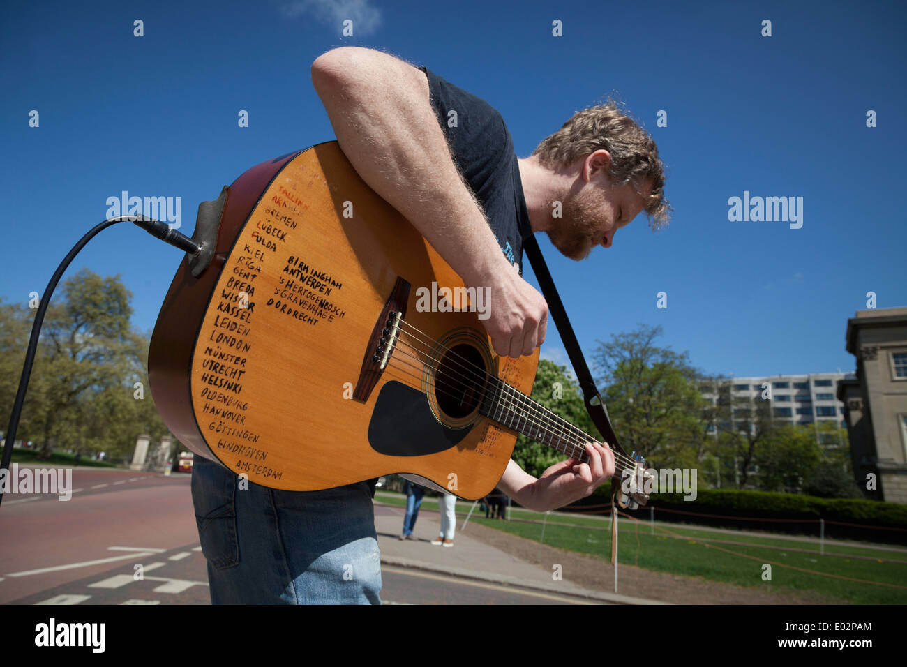 Street musician with amplified acoustic guitar list of places visited europe - Stock Image