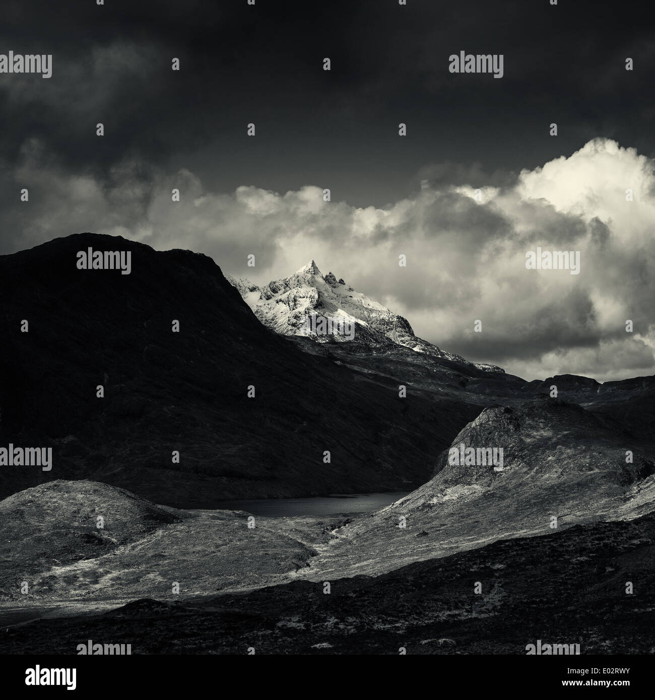 Snow tipped peak of Sgùrr nan Gillean ,Black Black Cuillin and Loch na Creitheach from Camasunary, Isle of Skye.Scotland - Stock Image
