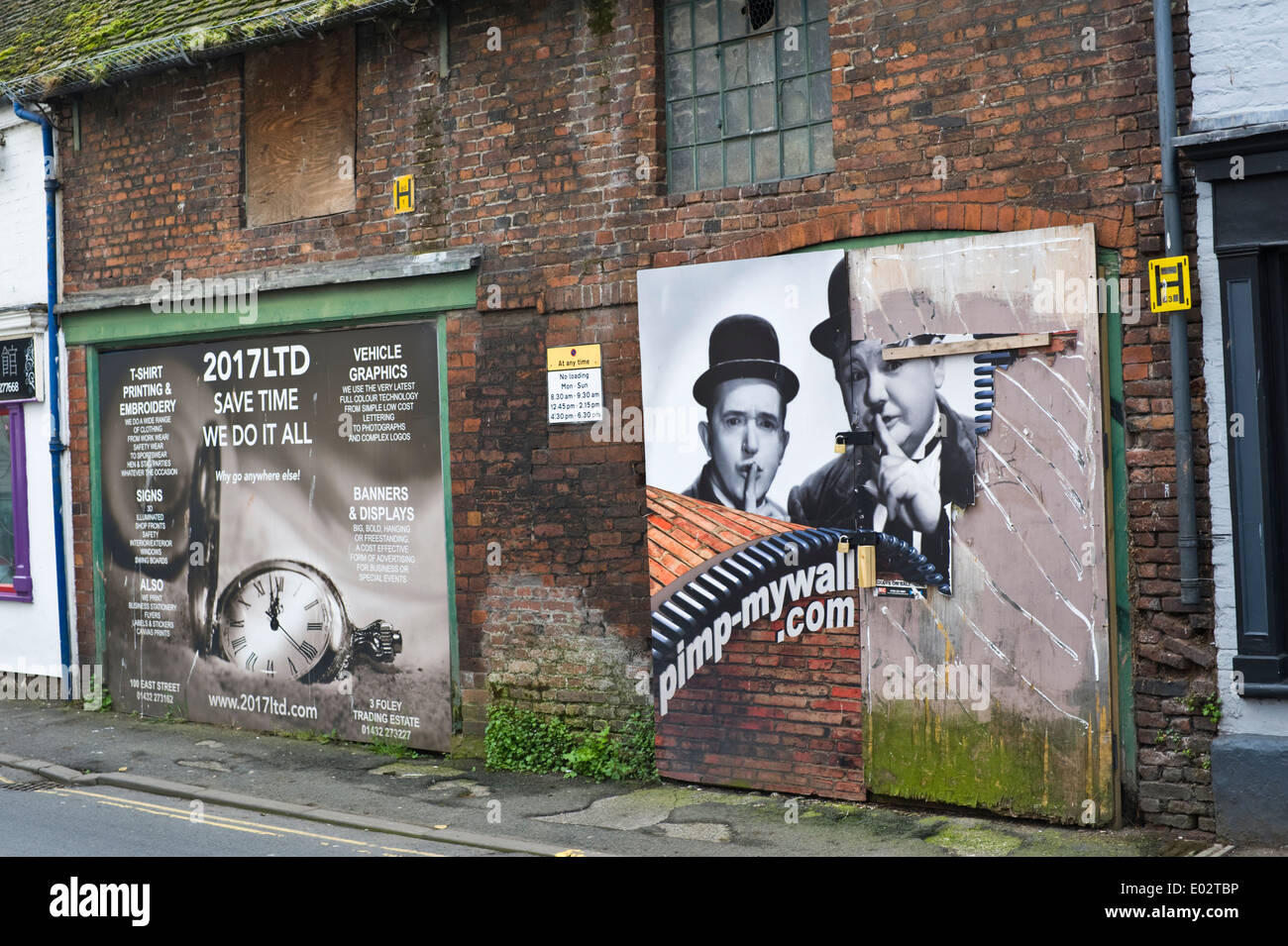 Attempt to improve derelict building with poster graphics in Hereford Herefordshire England UK - Stock Image