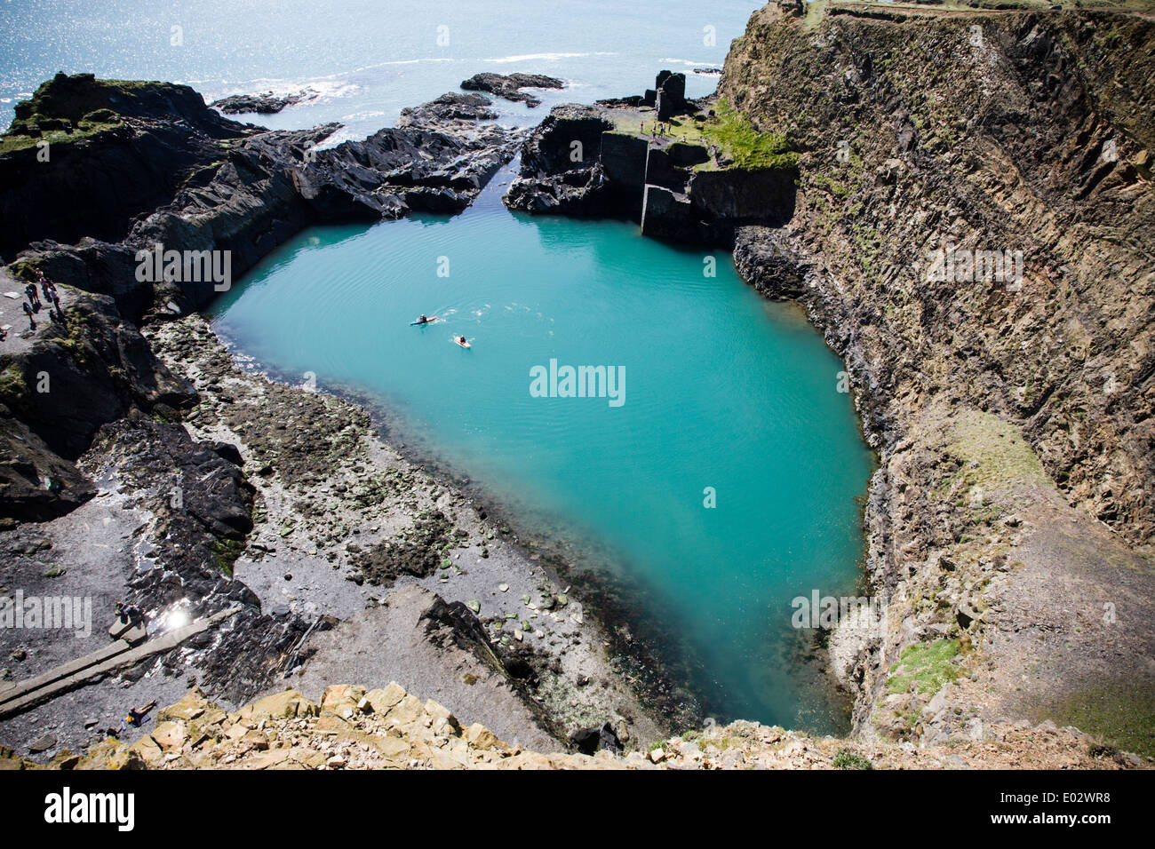 Two kayakers in the Blue Lagoon in Abereiddi Bay, Pembrokeshire, Wales. - Stock Image