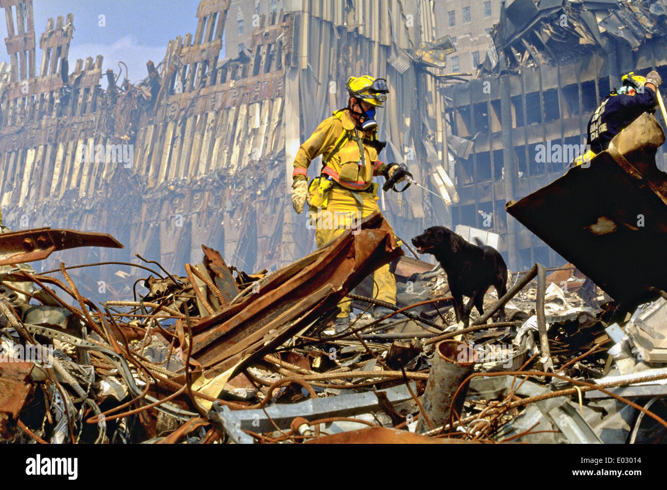 Urban Search and Rescue teams search for survivors amongst the wreckage of the World Trade Center following a massive Stock Photo