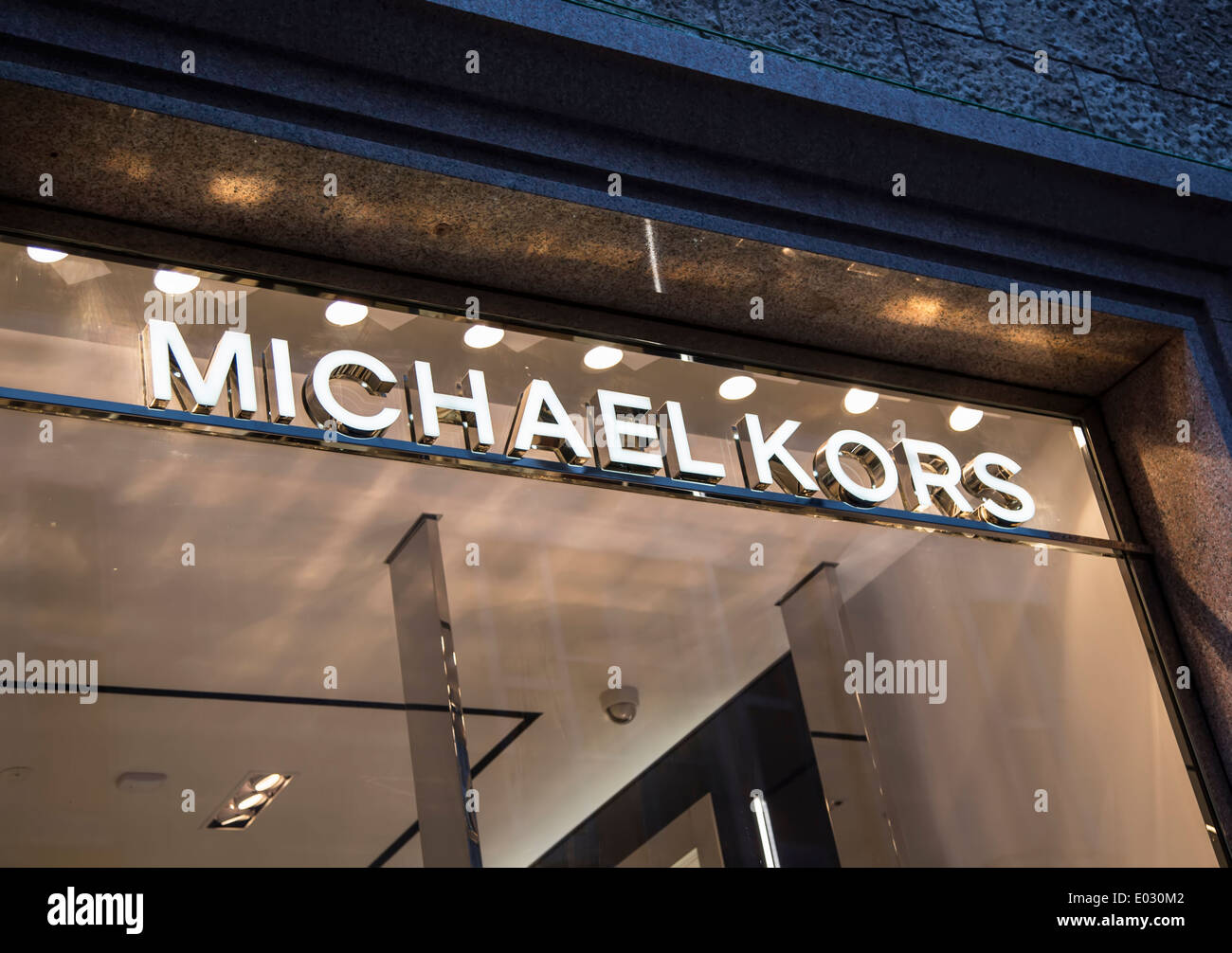 MILAN, ITALY - MARCH 9, 2014: View at Michael Kors shop in Milan. Michael Kors is a New York City-based fashion designer widely known for designing classic American sportswear for women. - Stock Image