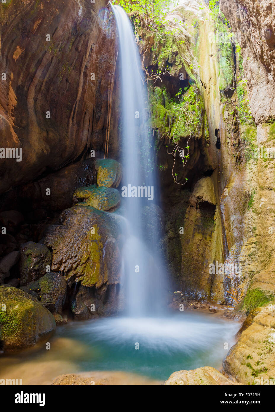 Small waterfall deep in rain forest, shot in long exposure - Stock Image