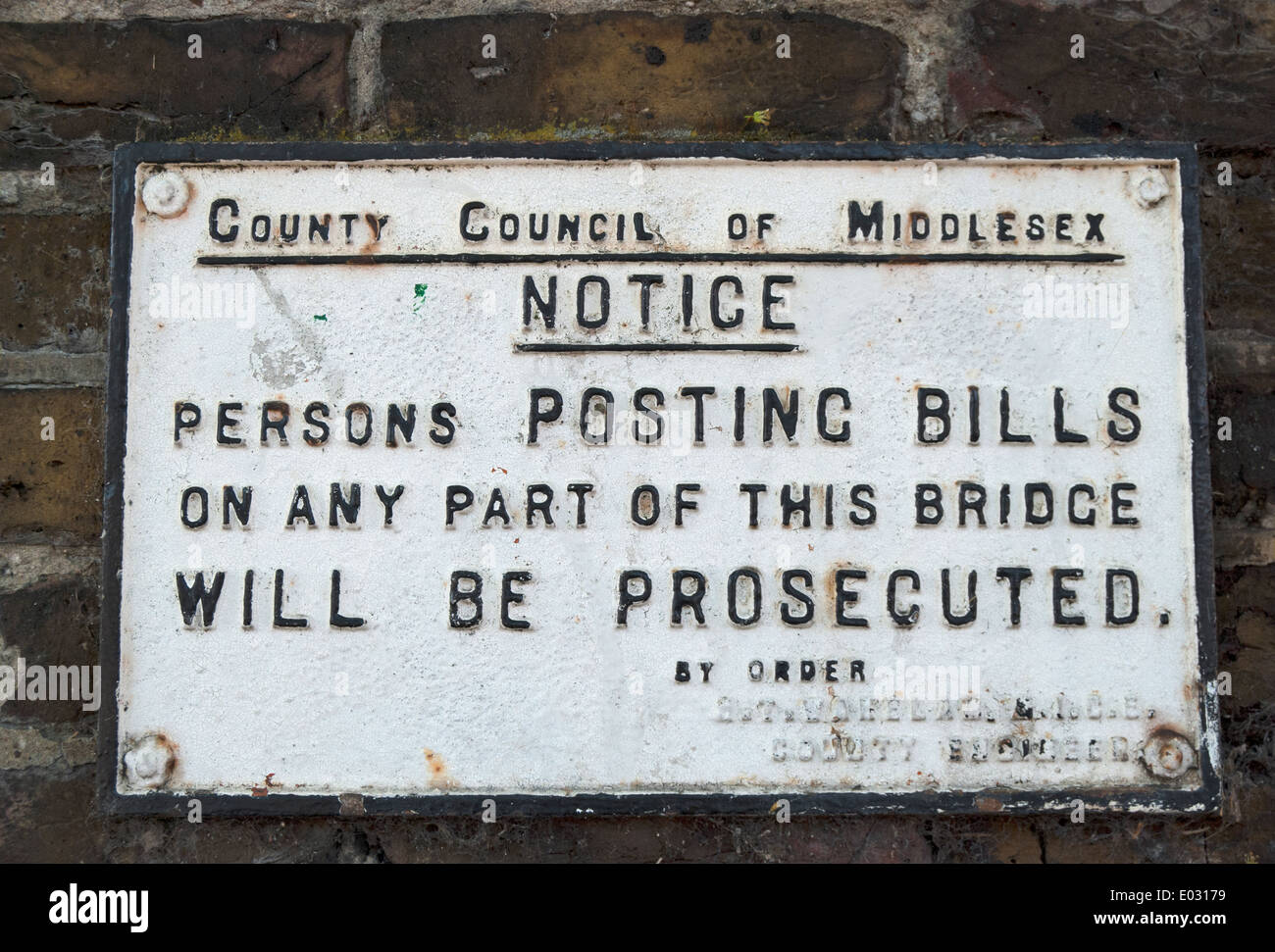 vintage middlesex county council sign warning that anyone posting bills on bridge will be prosecuted - Stock Image