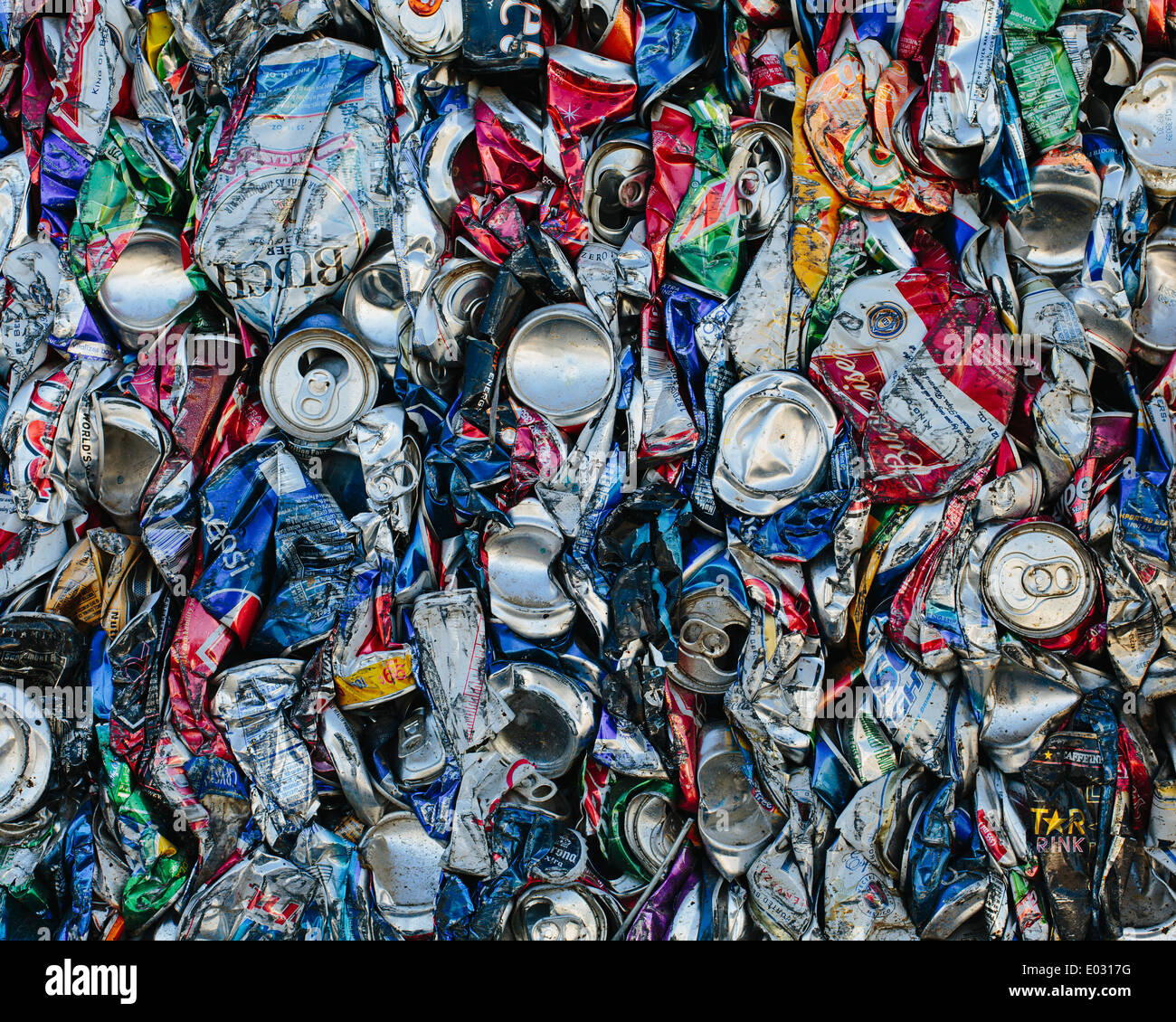 Mass of aluminium cans being processed at a recycling plant. Stock Photo