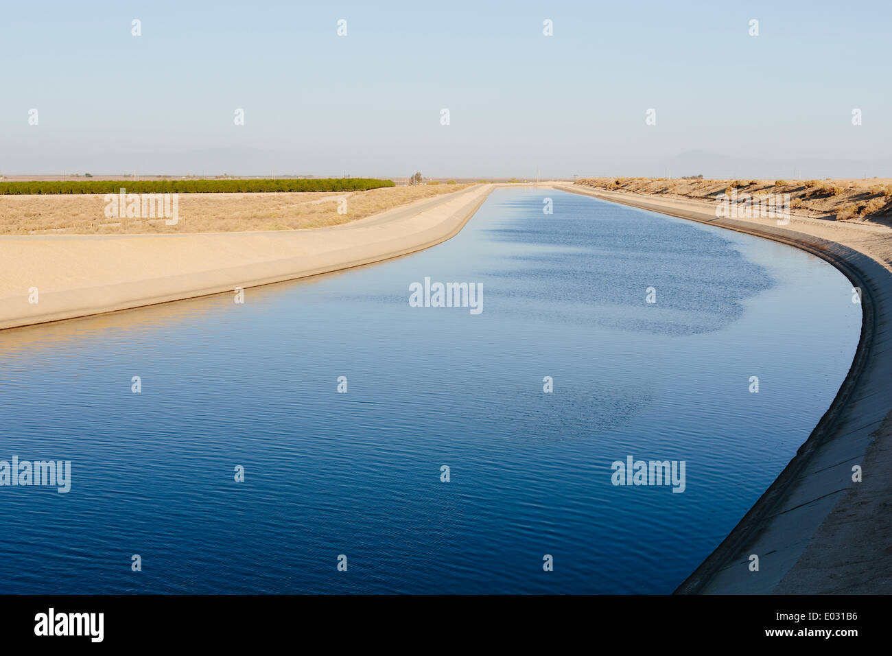 Irrigation canal serving drought-ridden agricultural areas of Central Valley California. - Stock Image