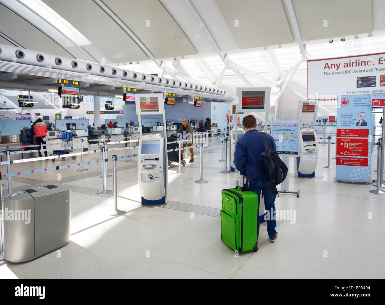 Person at self check in machine at Toronto Pearson International airport - Stock Image
