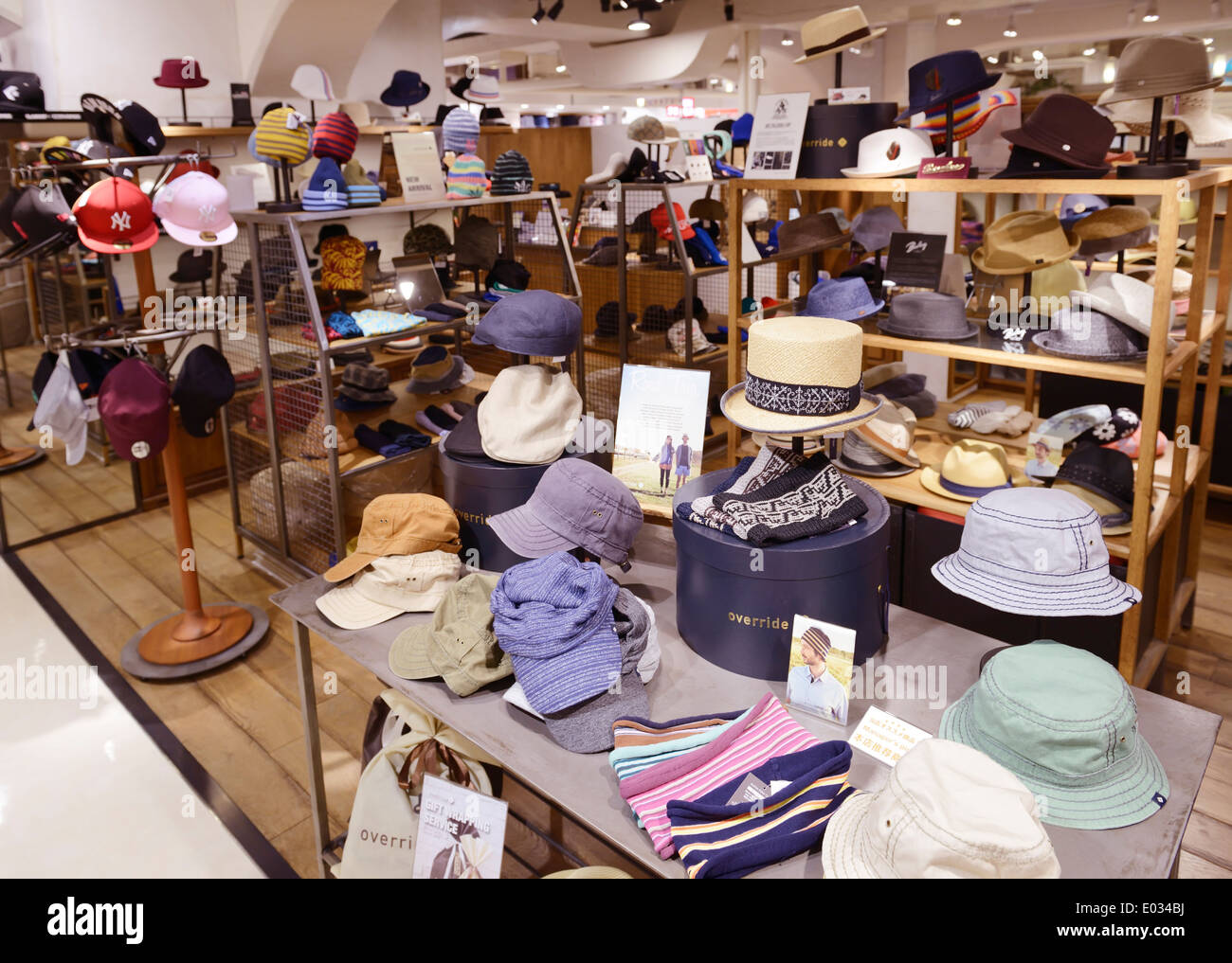 Headwear hats and caps in a store in Tokyo Japan - Stock Image