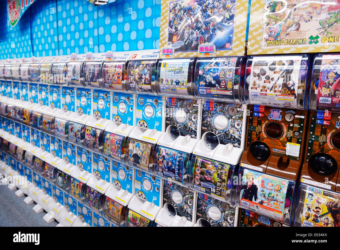 Capsule station, slot machines with action figures anime characters in Tokyo, Japan - Stock Image