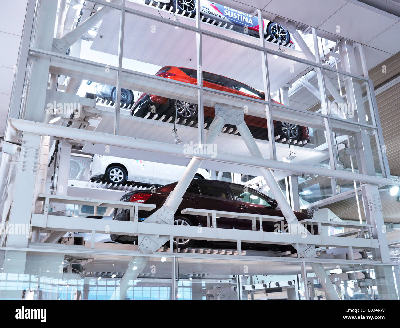Several cars on elevator in a multi-level parking garage at Toyota Mega Web city showcase at Odaiba, Tokyo, Japan - Stock Image