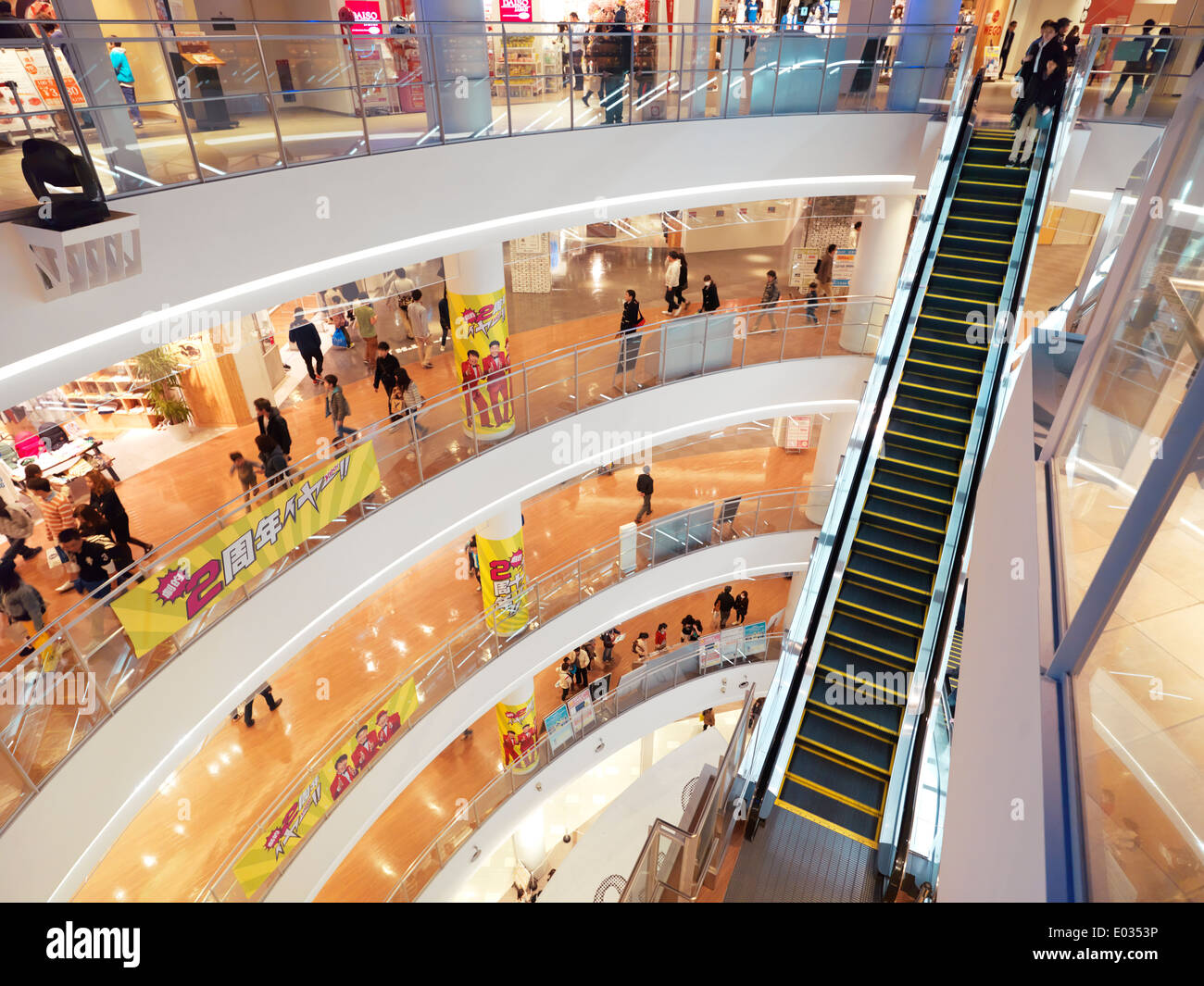Multiple levels and escalators at Diver City shopping complex in Odaiba, Tokyo, Japan - Stock Image
