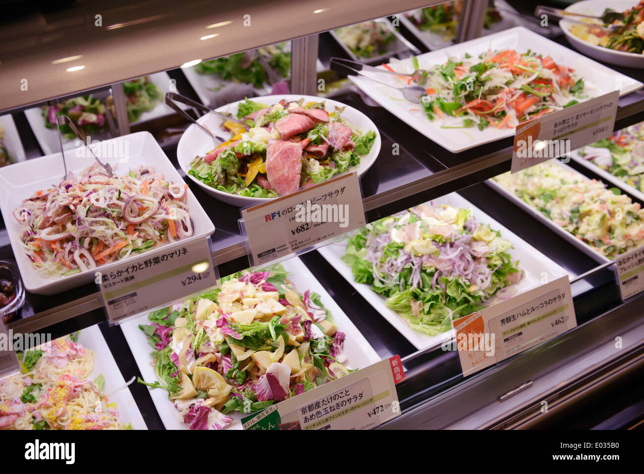 Salads on display in a Japanese supermarket. Tokyo, Japan. - Stock Image