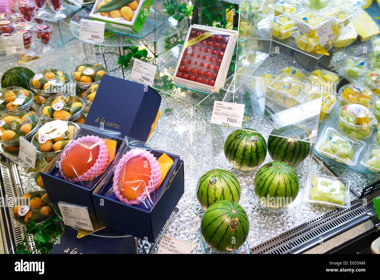 Expensive fruits, watermelon, mango on display in a Japanese supermarket. Tokyo, Japan. - Stock Image