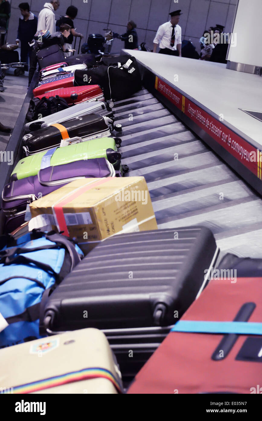 Row of suitcases, luggage on airport baggage claim conveyor carousel, Toronto Pearson International Airport, Ontario, - Stock Image