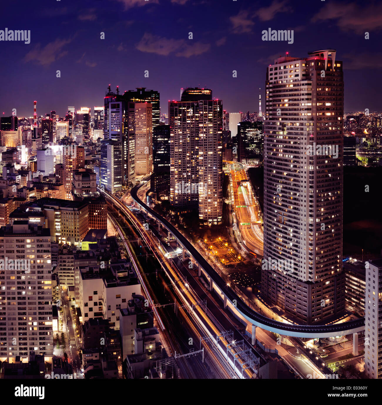 Tokyo city aerial nighttime view with illuminated highways and train lines. Minato, Tokyo, Japan. - Stock Image