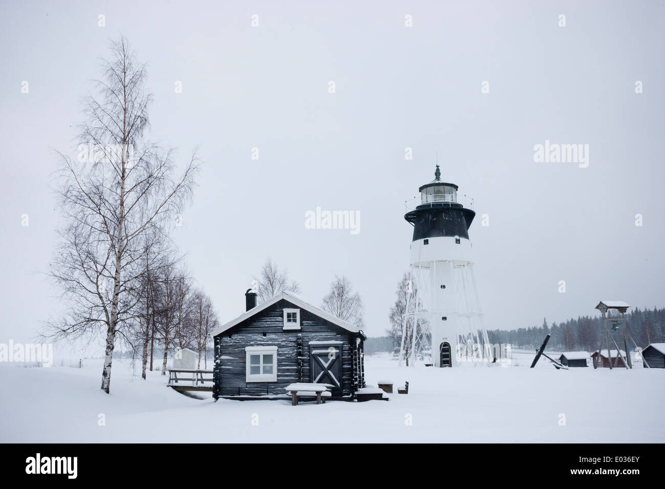 JAVRE, SWEDEN Lighthouse and cabin in winter. Stock Photo