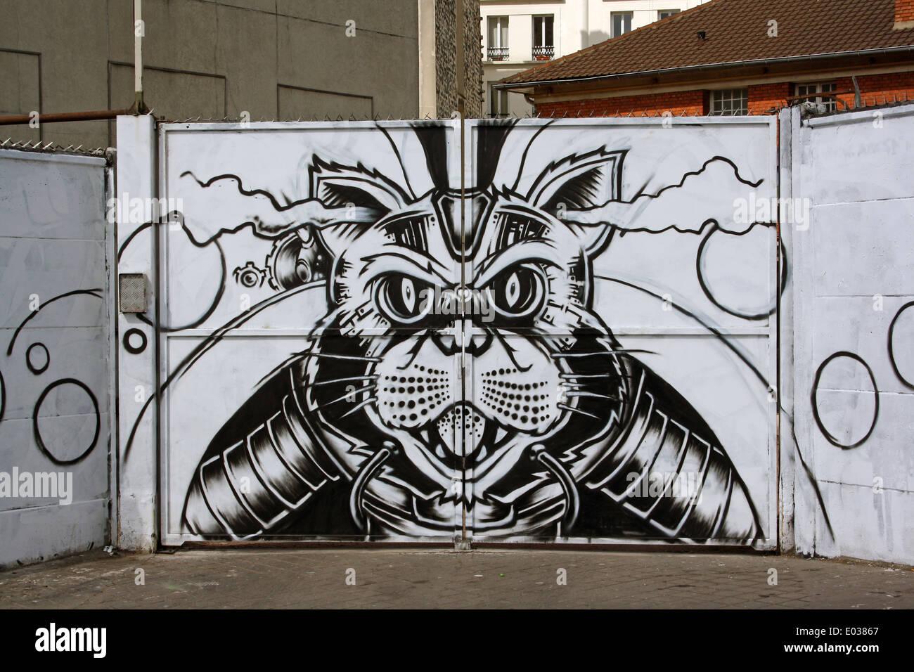 Paris, Ferocious cartoon cat on gates to yard. Stock Photo