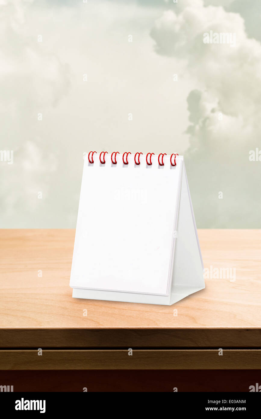 Blank desk calendar at wooden table, copy space for your design. - Stock Image