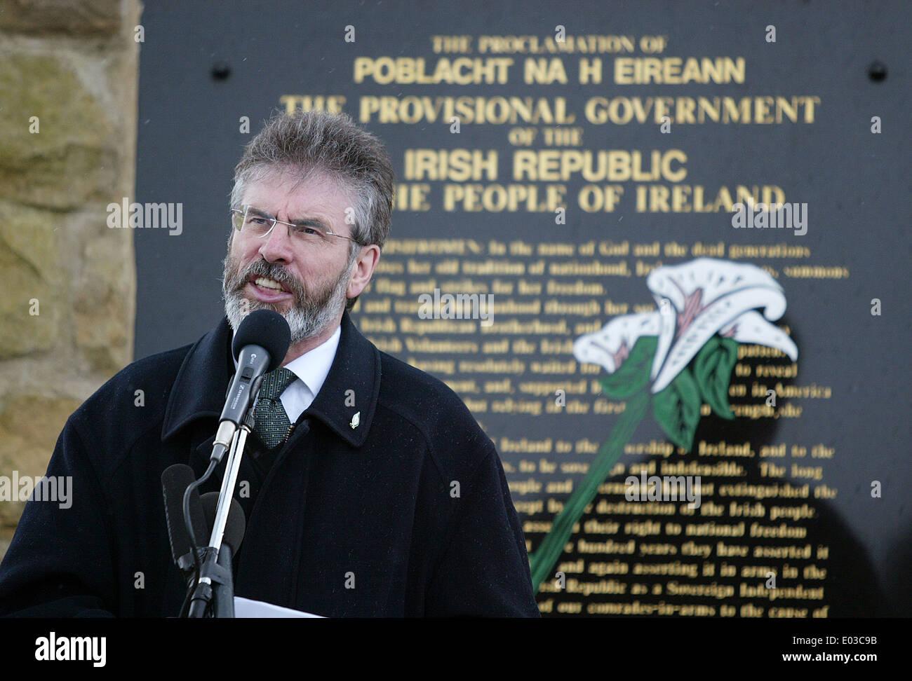 Sinn Fein president Gerry Adams speaking at a Easter Rising commemoration in MIlltown Cemetery Belfast - Stock Image