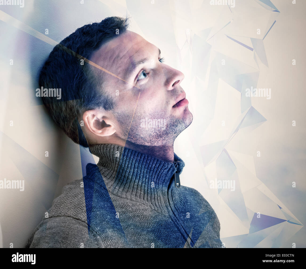 Young dreamy man conceptual portrait with technology pattern - Stock Image