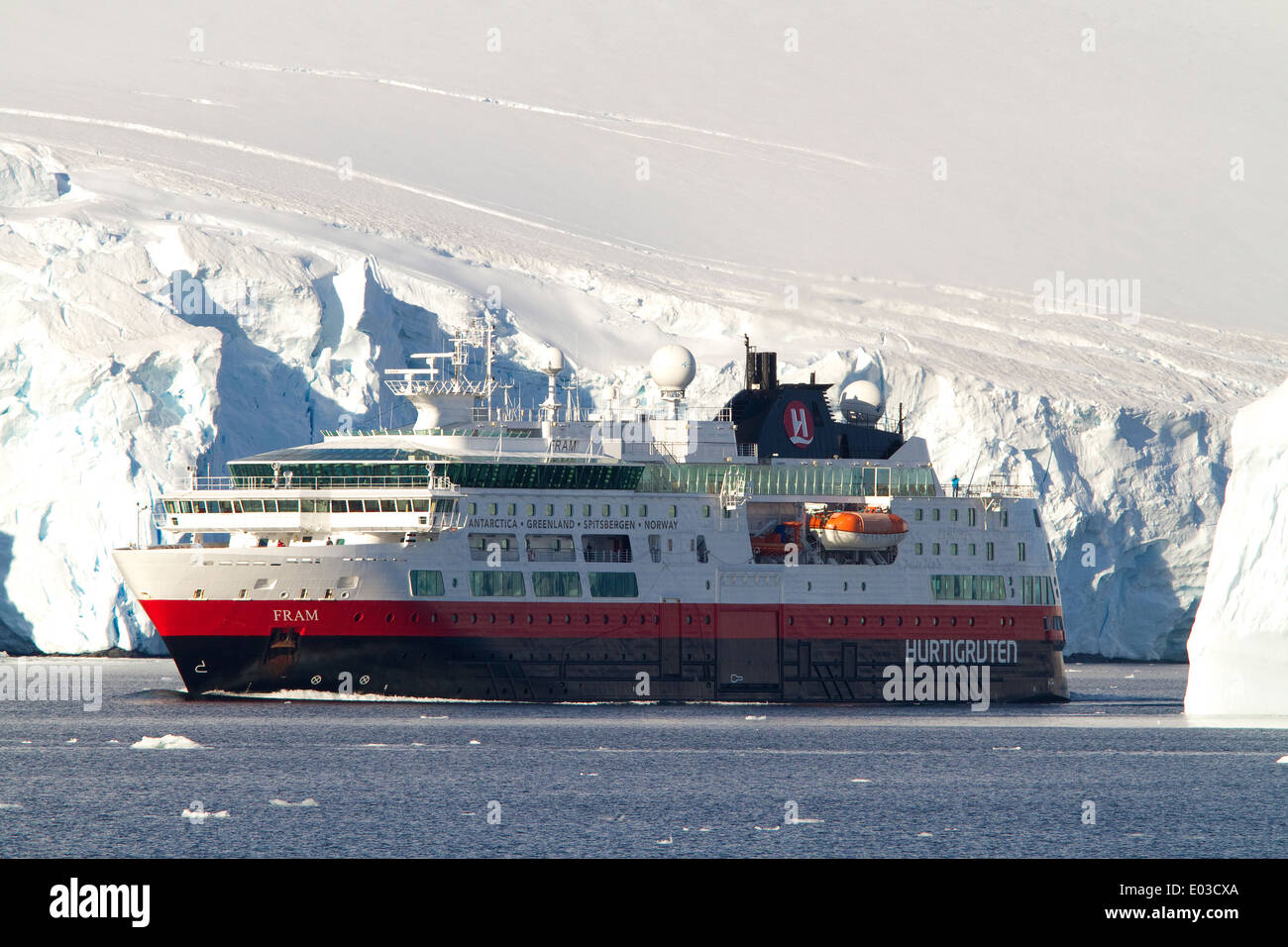 Cruise ship the Fram during a cruise in Antarctica with Antarctic glacier and iceberg. - Stock Image