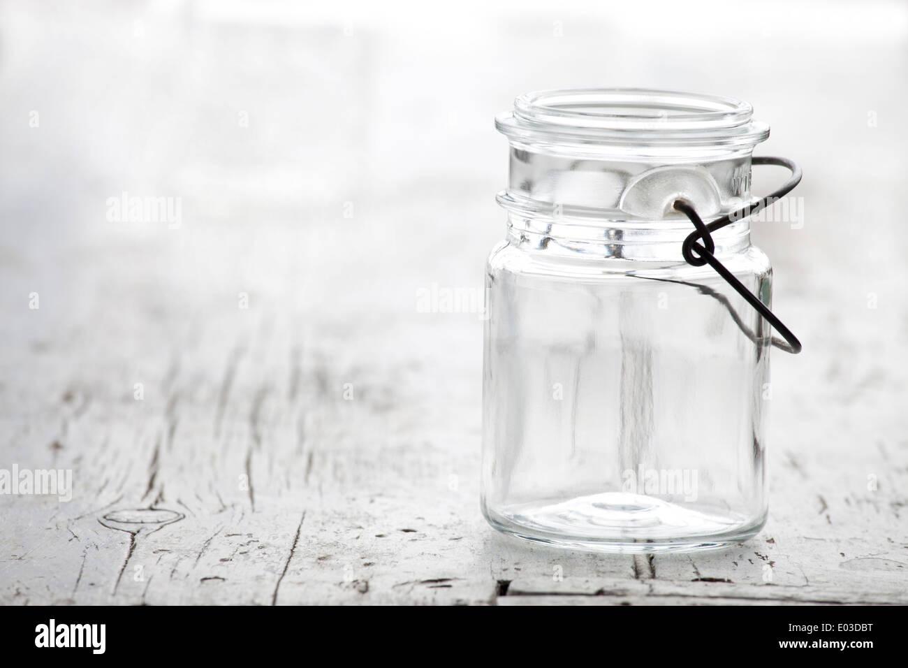 Empty Mason Jar on vintage white wood - Stock Image