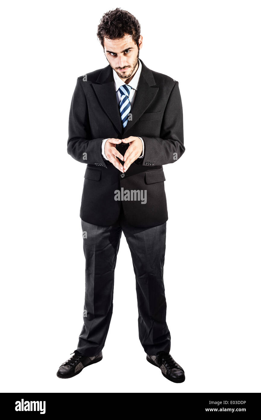 a young and handsome businessman in an evil pose isolated over a white background - Stock Image