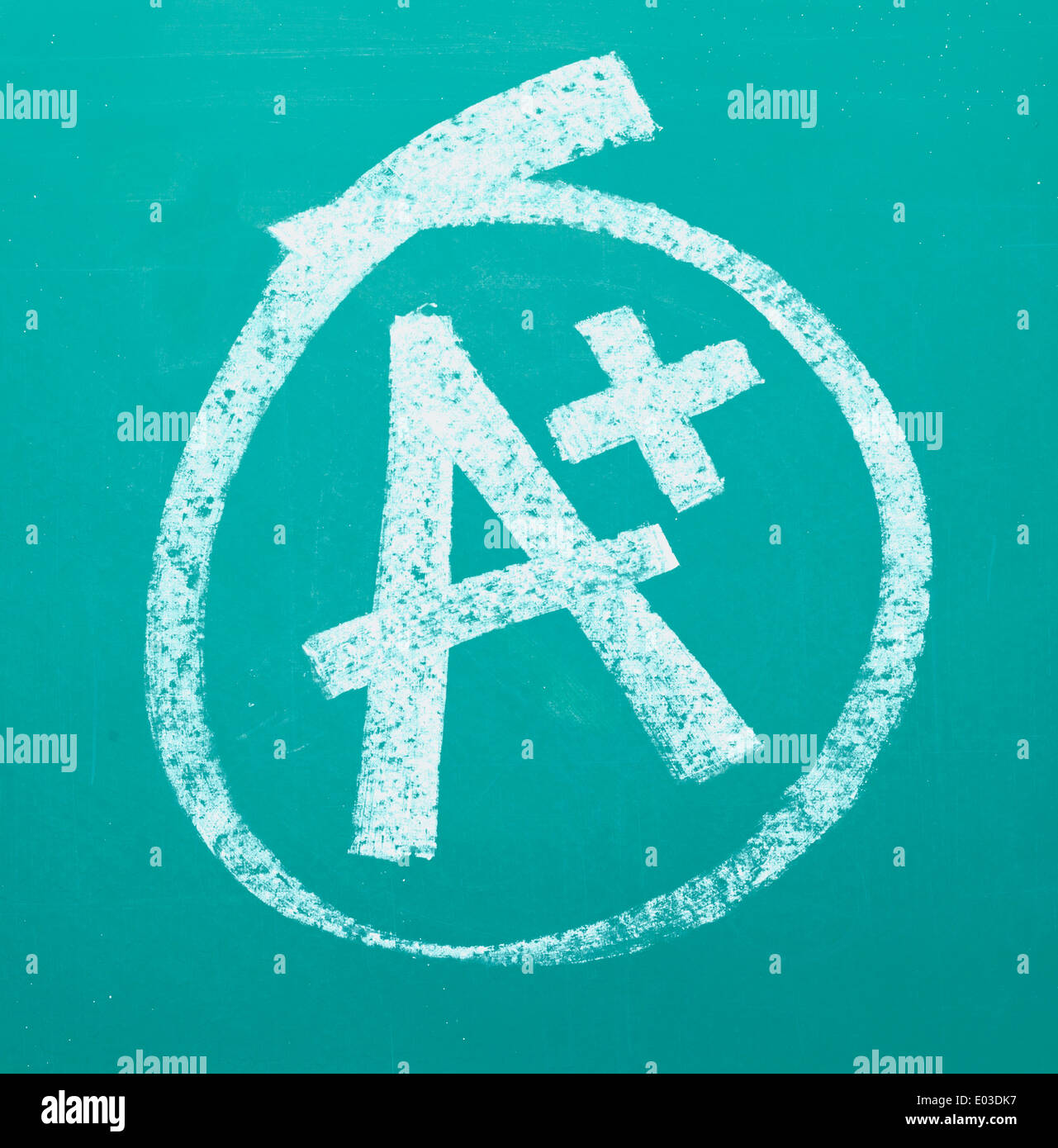 A grade drawn and circled on a chalk board. - Stock Image