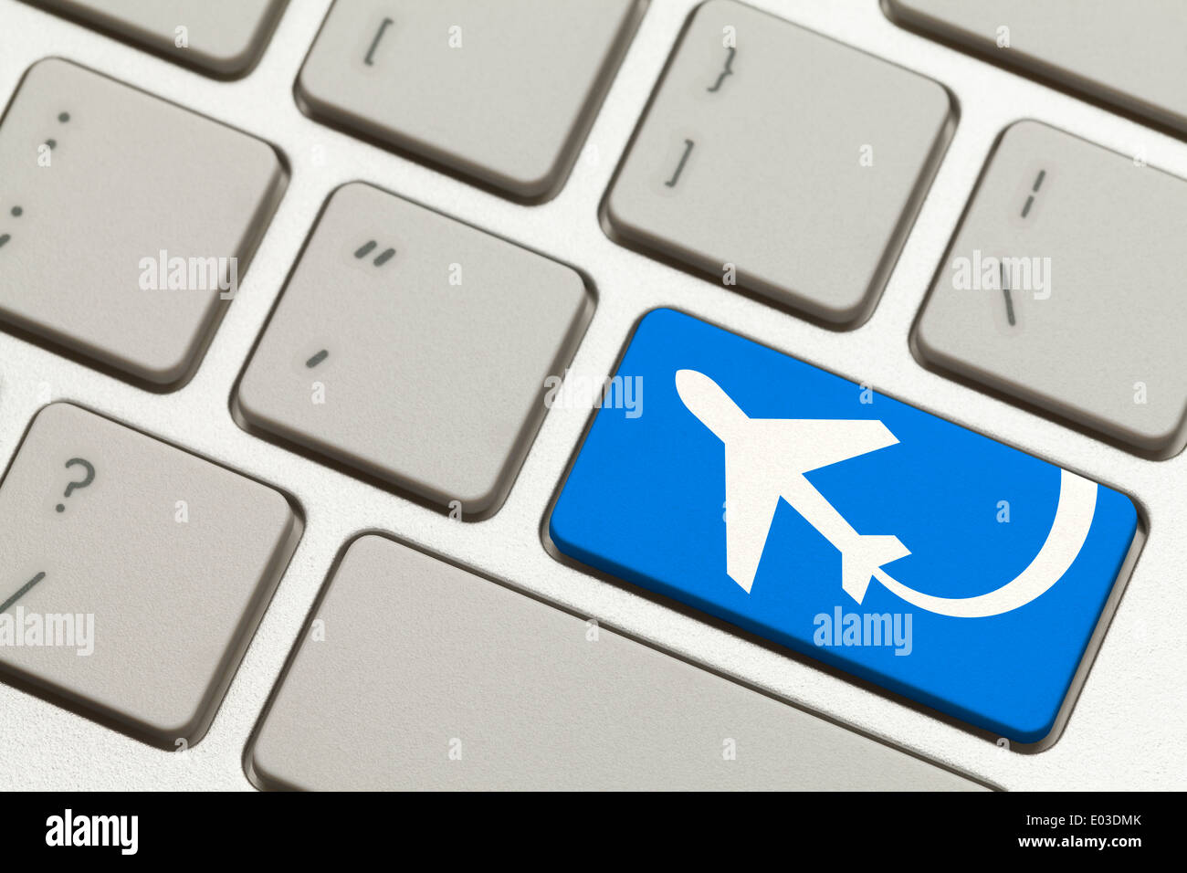 Close Up of Blue Key with Airplane on Keyboard. - Stock Image