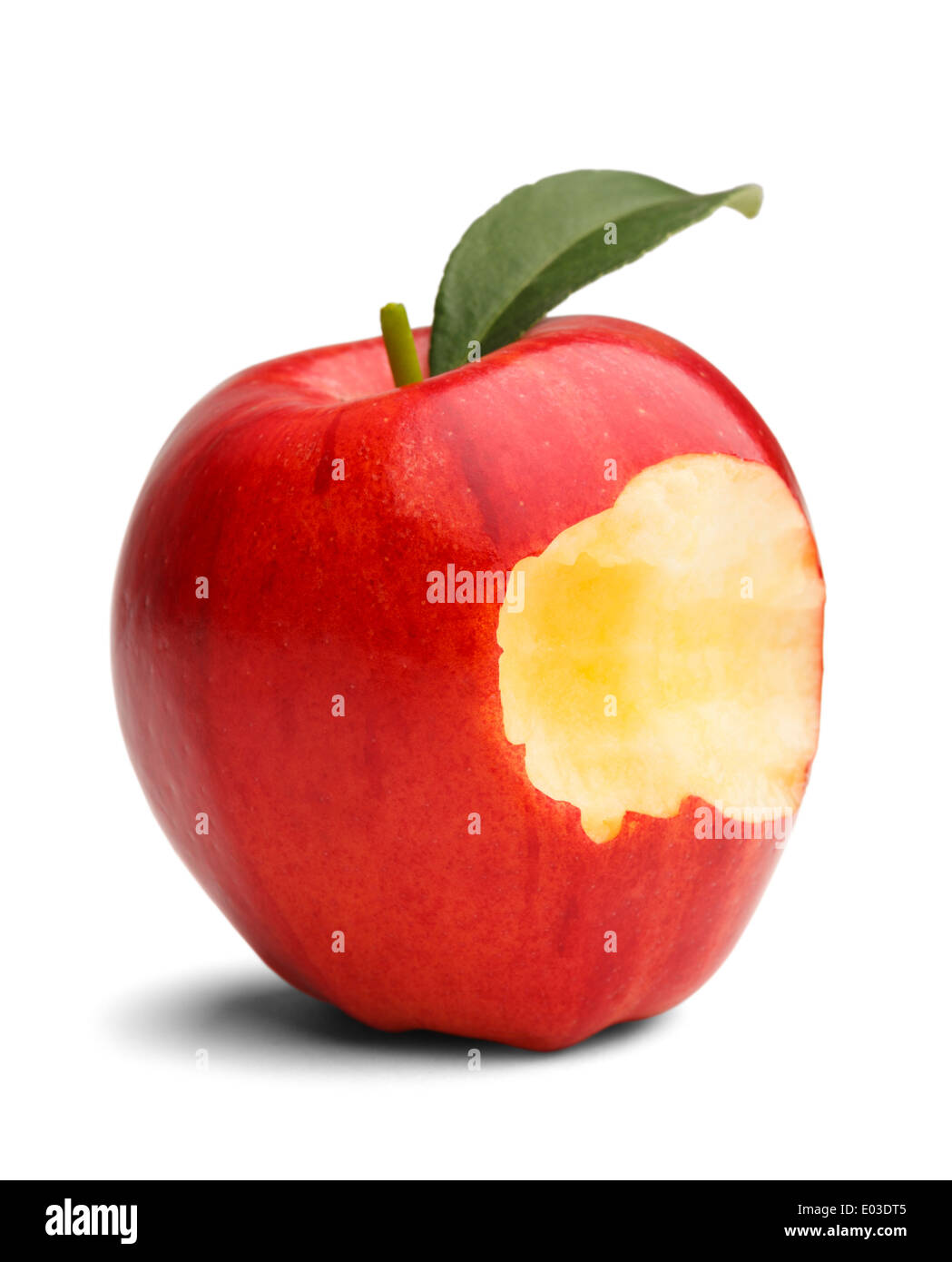 Red apple with green leaf missing a bite isolated on a white background. - Stock Image