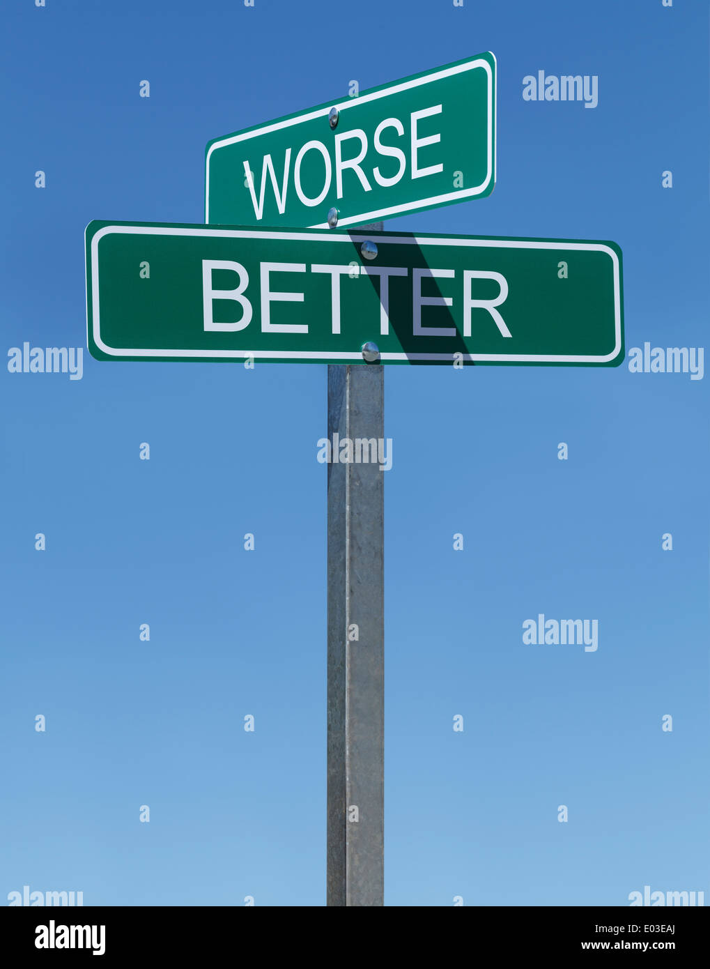 Green Street Signs Better and Worse on Metal Pole With Blue Sky Background. - Stock Image