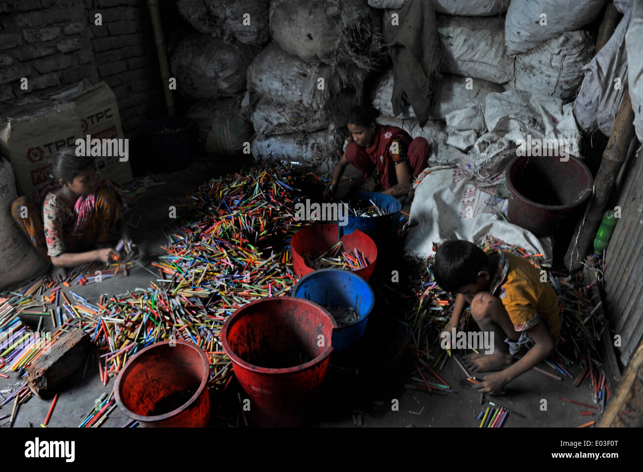 DHAKA, BANGLADESH - APRIL 30: According to the Labor Law of Bangladesh, the minimum legal age for employment is 14. But 90 percent of child laborers work in small factories and workshops and on the street. The enforcement of labor law is virtually impossible. Poverty causes families to send children to work, often in hazardous and low-wage jobs. Children are paid less than adults, with many working up to twelve hours a day. Full-time work frequently prevents children from attending school. Long hours, low or no wages, poor food, isolation, and hazards in the working environment can severely af - Stock Image