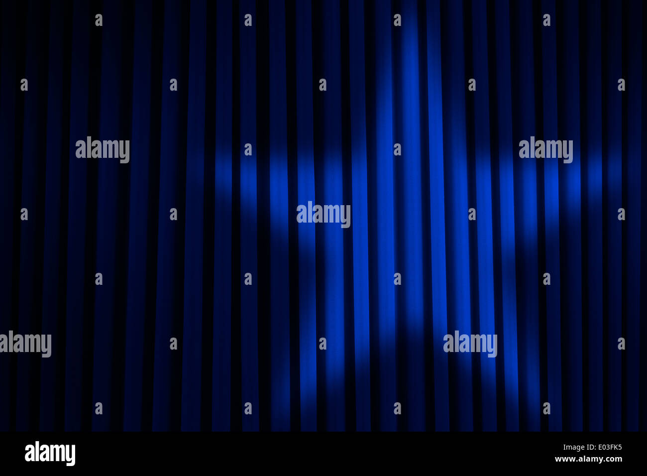 Blue Stage Curtain With Star Spotlight. - Stock Image
