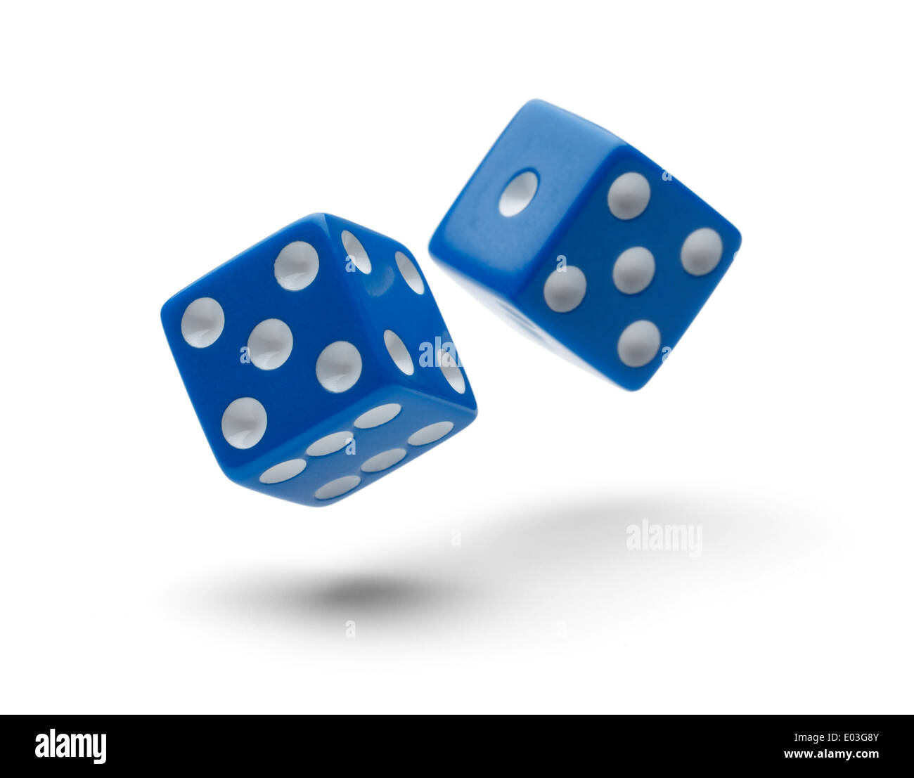 Two Dice Rolling through the Air Isolated on White Background with Shadows. - Stock Image