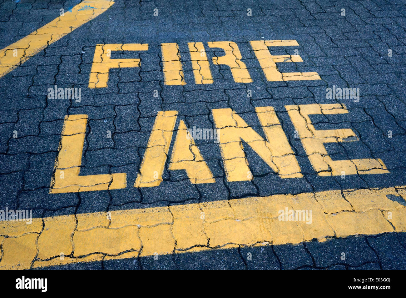 Fire Lane sign painted on the ground, Granville Island, Vancouver, British Columbia, Canada - Stock Image