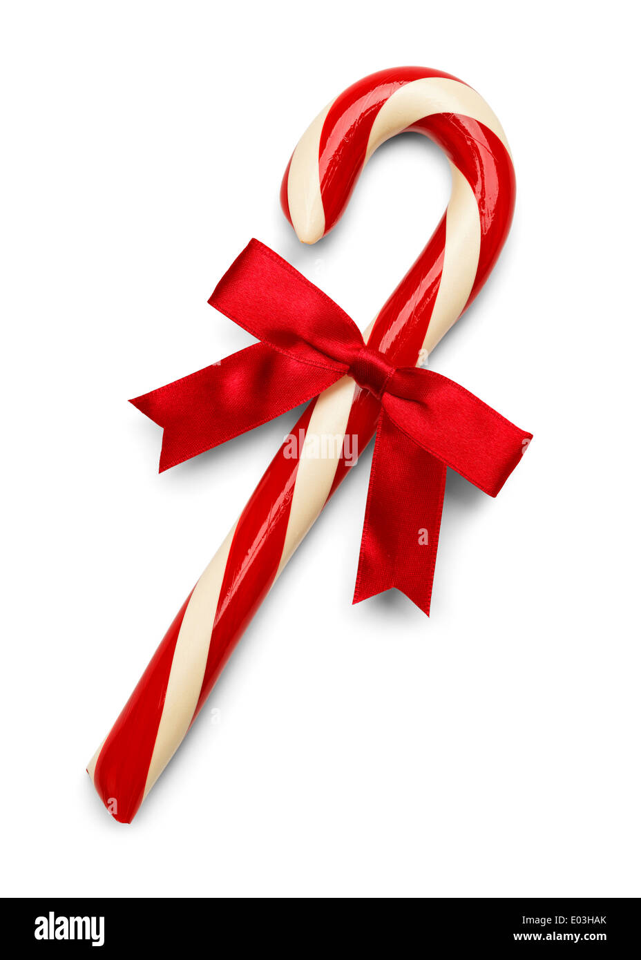 Christmas Candy Cane with Red Bow Isolated on White Background. - Stock Image