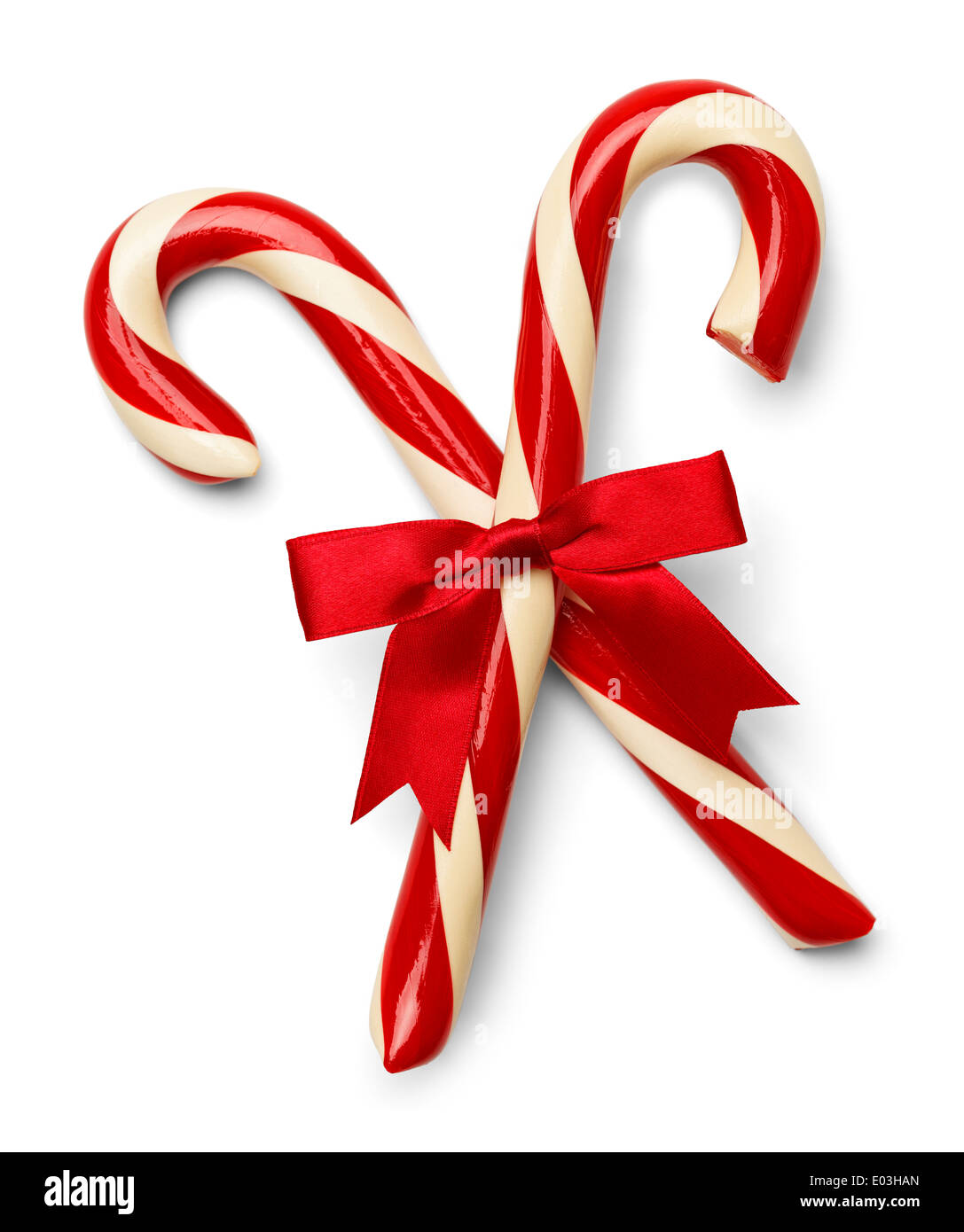 Two Candycanes Crossed with Red Ribbon Isolated on White Background. - Stock Image