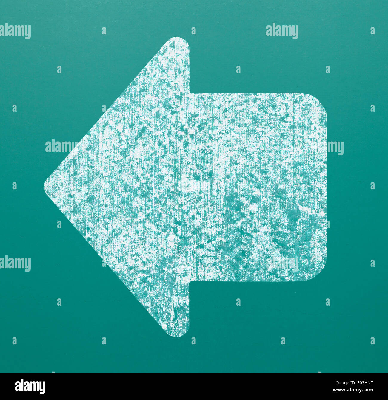 Large White Arrow on Green Chalk Board. - Stock Image