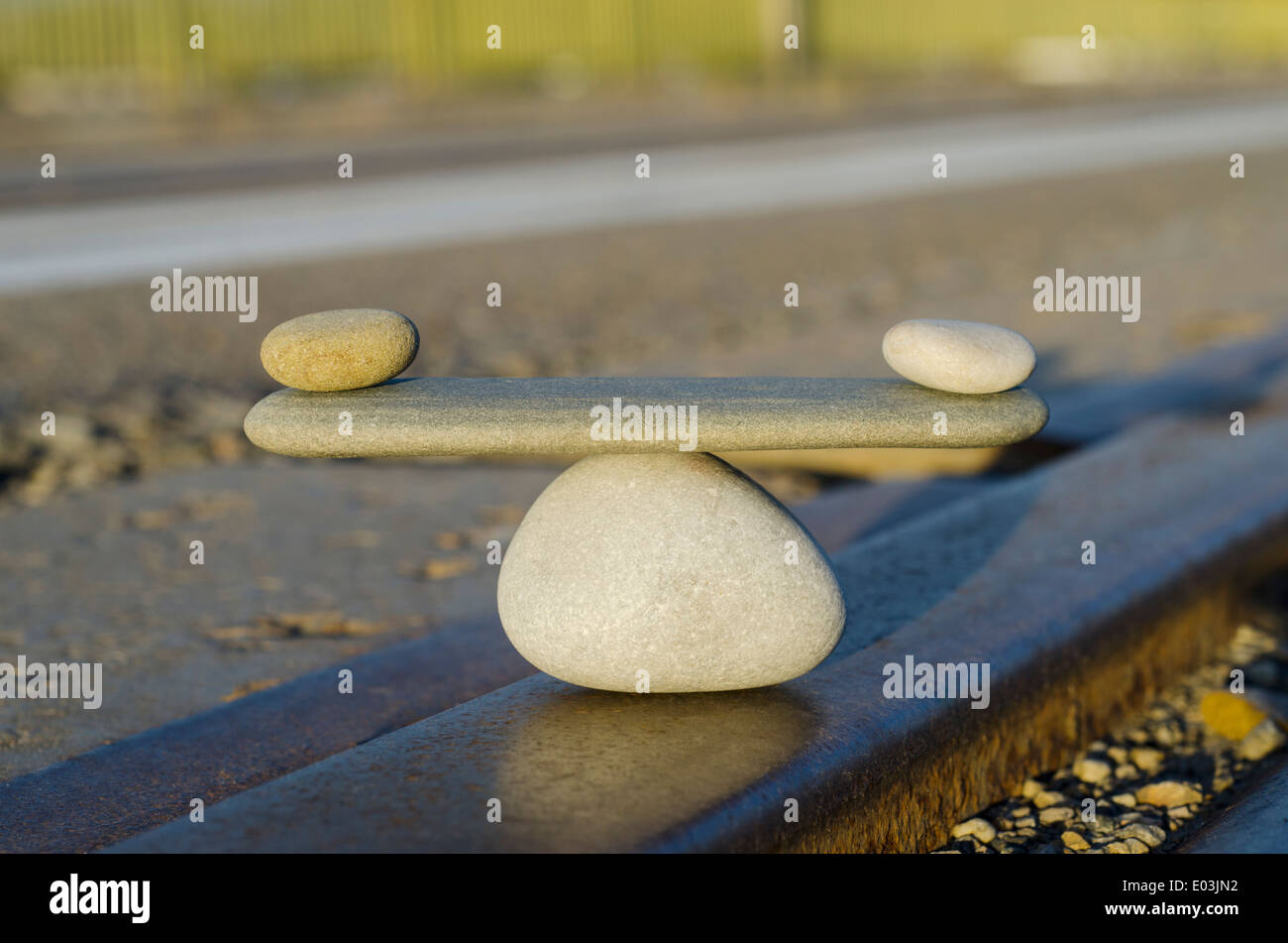 Symbol Scales is made of stones of various shapes - Stock Image