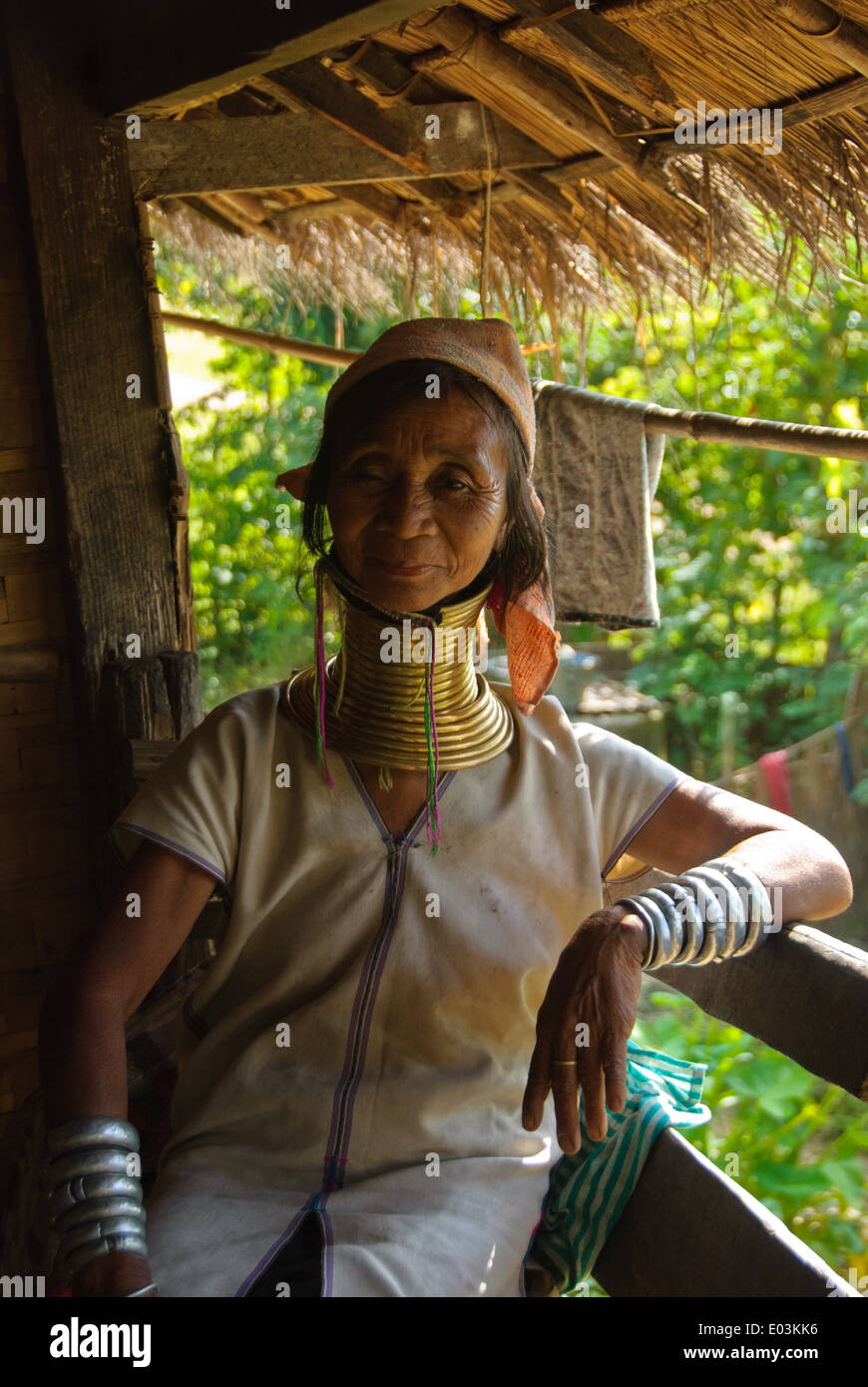 A Padaung woman with her brass neck coils and silver bangles Stock Photo
