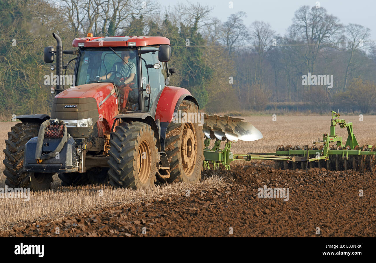 Ploughing with farrow press attached - Stock Image