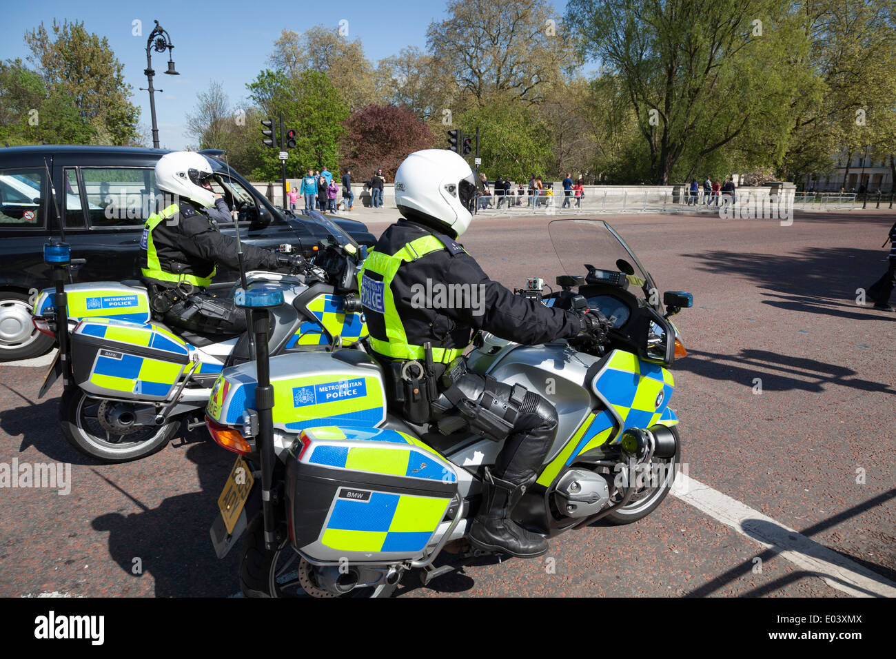 Two armed Metropolitan Police Motorcyclists. - Stock Image