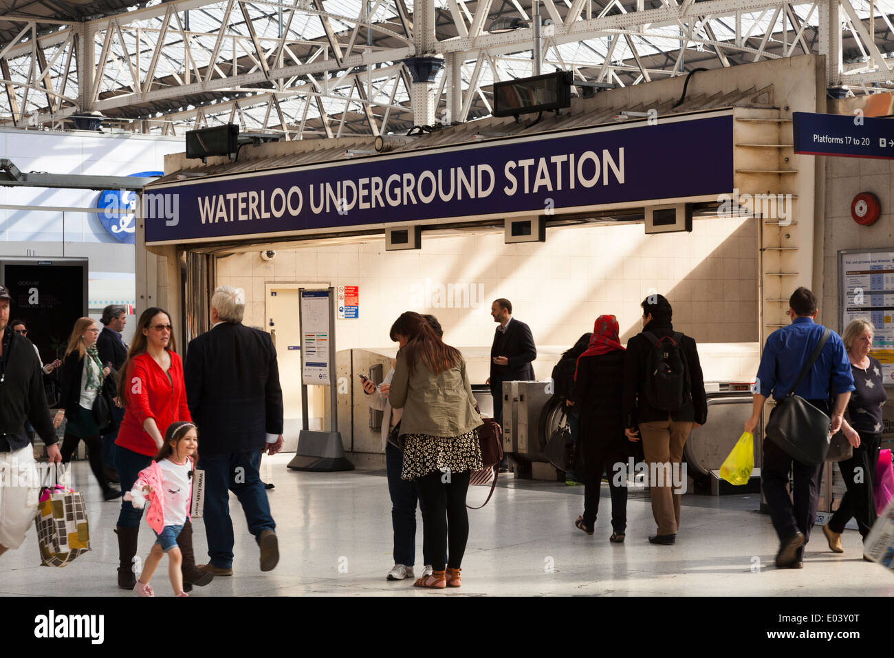 People using Waterloo Underground Station entrance on the concourse. - Stock Image