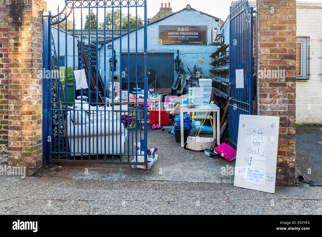 Yard sale - householder's old goods and possessions for sale at Twickenham business, Greater London, UK - Stock Image