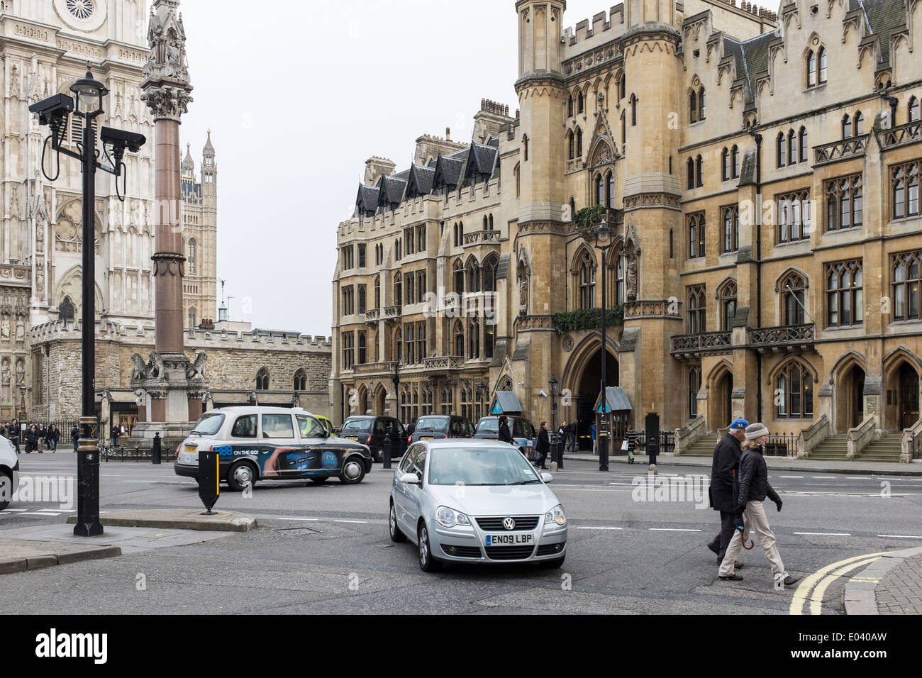View of Westminster Abbey, Entrance to Dean's Yard and Westminster School War Memorial, London - Stock Image