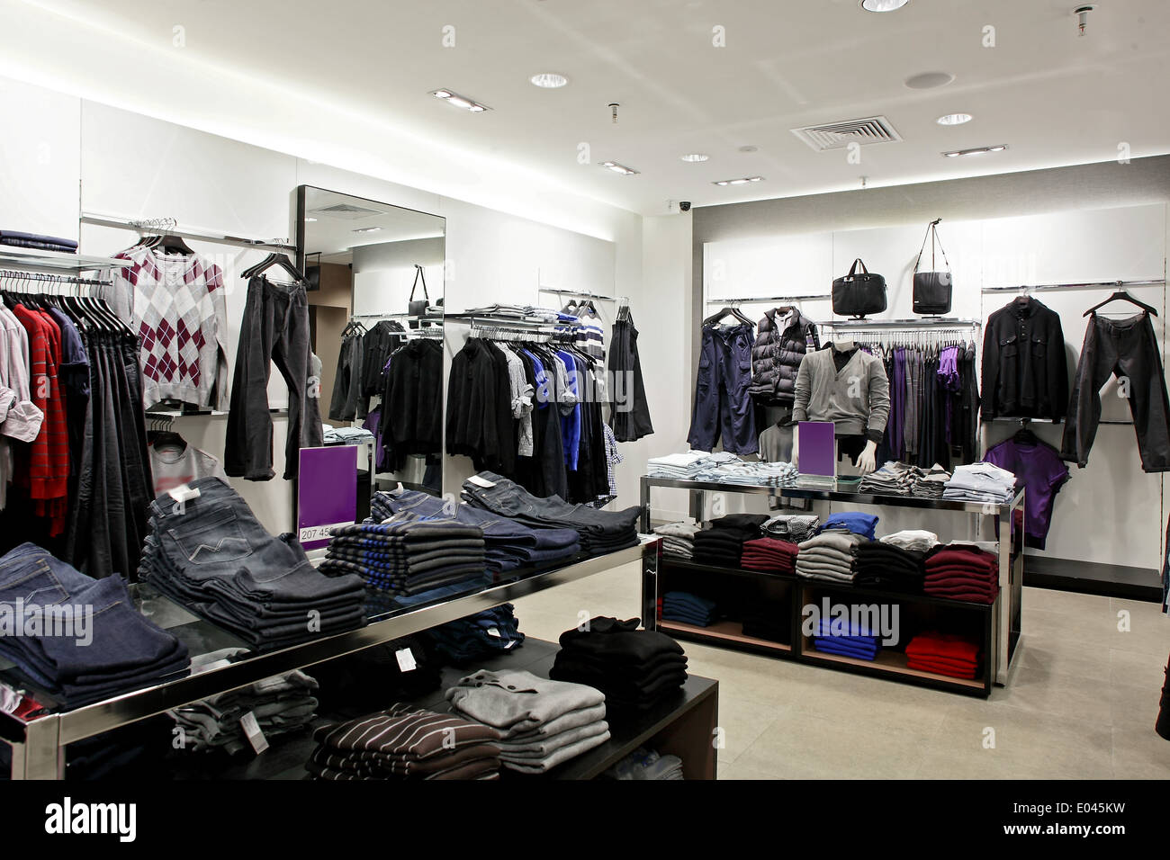 bf69a40ad9c6 luxury and fashionable european different clothes shop Stock Photo ...