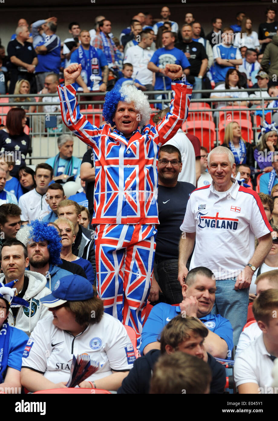 Peterborough United football supporter wearing patriotic union jack suit - Stock Image