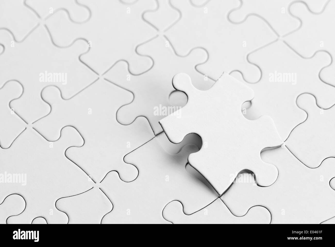 White Puzzle with Copy space and Puzzle Piece. - Stock Image